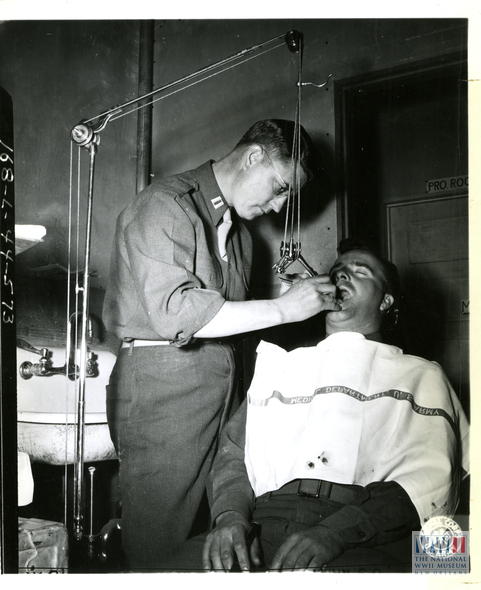Photograph of Soldier having Dental Work Performed on him